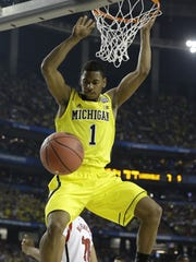 At Michigan, Glenn Robinson III dunked against  Louisville during  the 2013 NCAA Final Four tournament.