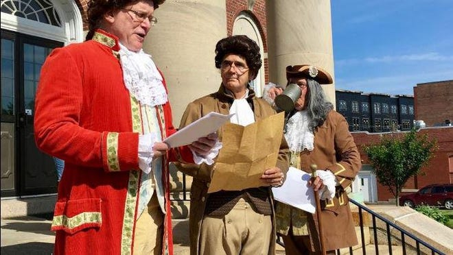 Thomas Jefferson (Mike Pomp), left, reads the Declaration of Independence on the steps of Dover City Hall in 2019 as John Adams (Don Briand) and Bejamin Franklin (Thomas Dunnington) watch during the traditional July 4 event. The Garrison Players won't be performing this year, but a replay will be shown on Channel 22 and via the city's website and social media platforms.