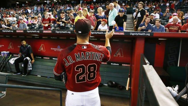 Arizona Diamondbacks' J.D. Martinez signs autographs before playing the Atlanta Braves on Wednesday, Jul. 26, 2017 at Chase Field in Phoenix, Ariz.