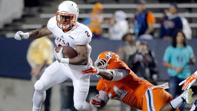 UTEP defensive lineman Silas Firstly can't hold on to UTSA running back Jarveon Williams during their game Saturday at Sun Bowl Stadium.