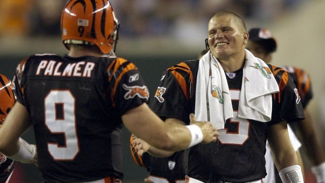 Bengals starter Jon Kitna celebrates from the bench as Carson Palmer passed for a TD in the third quarter of a preseason game in August of 2003.