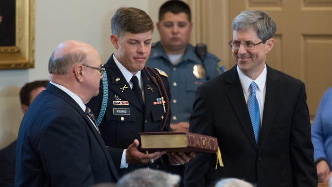 The Honorable Noel Eason Primos after being sworn in as Judge of the Superior Court of Delaware.  Edward Chester Merriel and First Lieutenant  Caleb Glenn Primos held the Bible during the oath of office.