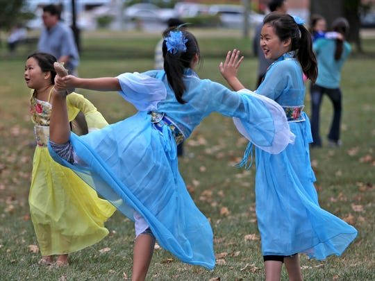 Girls warm up and play before performing during the Indianapolis Chinese Festival at Military Park, Saturday, September 12, 2015.