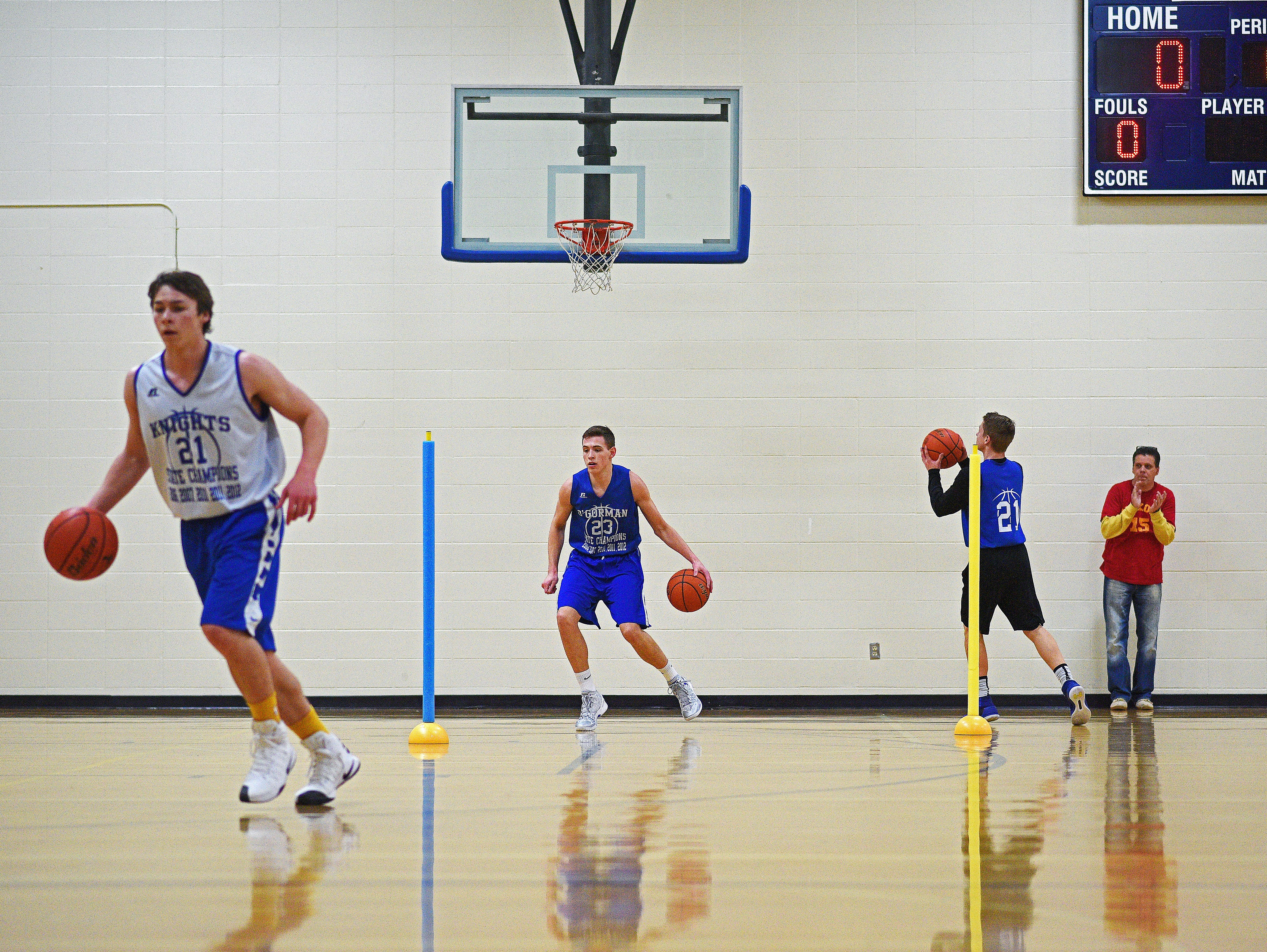 O'Gorman's Matt Cartwright, second from left, takes part in a drill during practice Tuesday, Feb. 14, 2017, at O'Gorman High School in Sioux Falls.