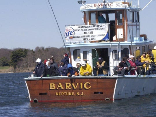Anglers aboard the party boat Barvic fish for flounder in the Manasquan River in 2003. Capt. Bill Burdge recently dismantled the Barvic.