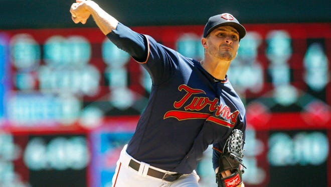 Minnesota Twins pitcher Jake Odorizzi throws against the Chicago White Sox in the first inning of a baseball game Sunday, May 26, 2019, in Minneapolis. (AP Photo/Jim Mone)