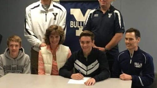 Yale senior Andrew Vincent poses for a photo after signing with Lake Superior State