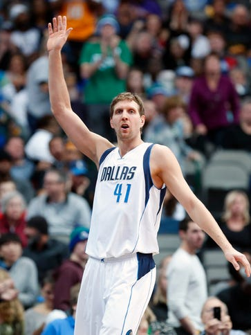 Dirk Nowitzki acknowledges the crowd after passing
