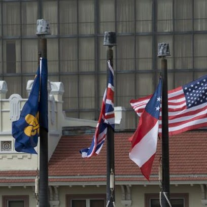 Commission voted 5-0 to keep flags as they are at the