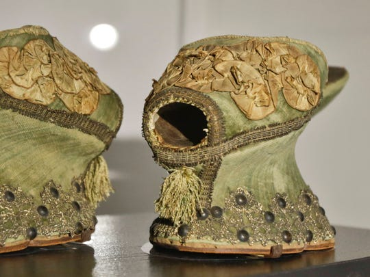 "In this Sept. 4, 2014 photo, a pair of 16th century Italian chopines is the oldest pair of shoes at an exhibit at the Brooklyn Museum in New York. ""Killer Heels: The Art of the High-Heeled Shoe"" highlights shoes from the 1600s to the present and is open from Sept. 10 through Feb. 15."