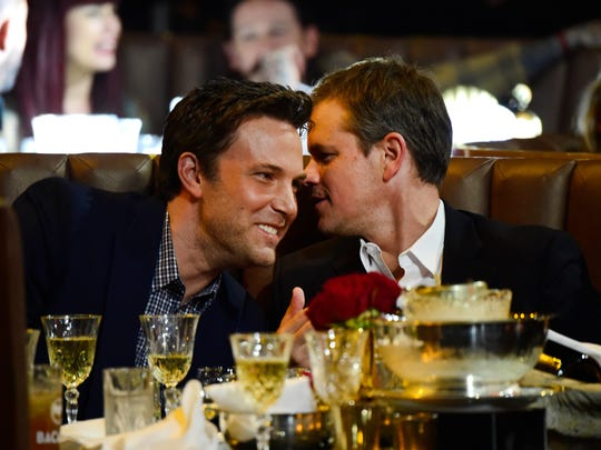 Ben Affleck, left, and Matt Damon share a table at Spike TV's Guys Choice 2016. The filmmakers and friends could be contenders again at the Oscars.