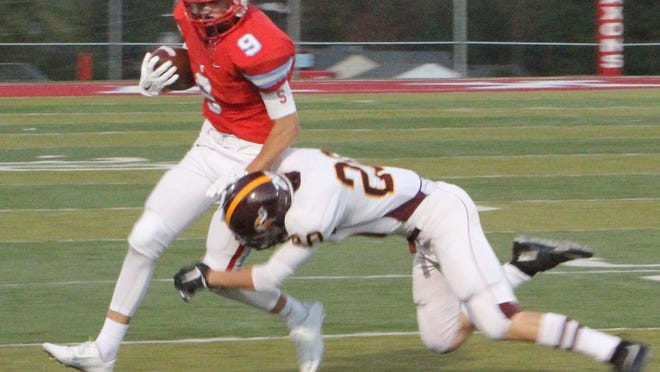 South Salem receiver Joseph Carey catches a pass against Forest Grove on Friday, Sept. 18, 2015.