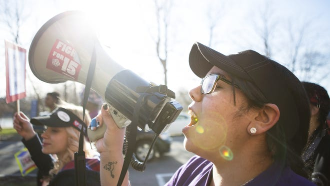 Alexsandra Candelaria leads marchers during a rally in April for a minimum wage of $15. Candelaria, who works at a Henrietta McDonald's, has also spoke openly about organizing workers into new local unions.