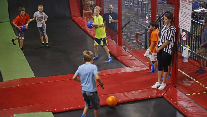 An employee keeps an eye on children as they play in the dodge ball area Sunday, June 28. 2015 at  AZ Air Time Indoor Trampoline Park & Family Fun Center in Scottsdale.