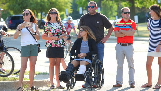 Cycling crash survivor Sheila Jeske watches hundreds of area cyclist preparing for a ride in Kalamazoo, Mich., on  June 14, 2016.