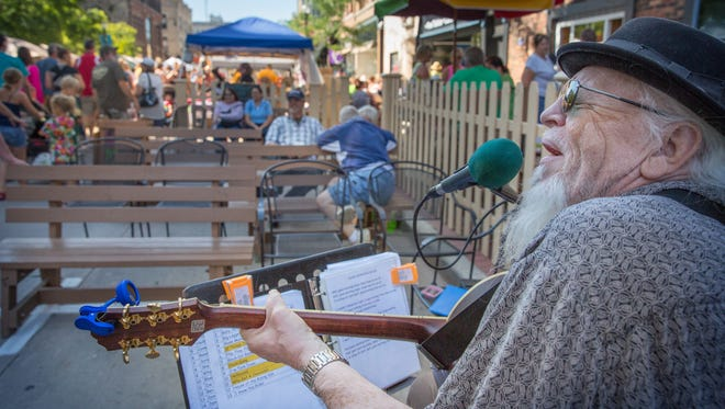 Michael Murphy performs outside the Magnet during the Farmer's Market. at the third Main Street Music Festival in 2015. The event featured more than 100 musicians, artists and entertainers.