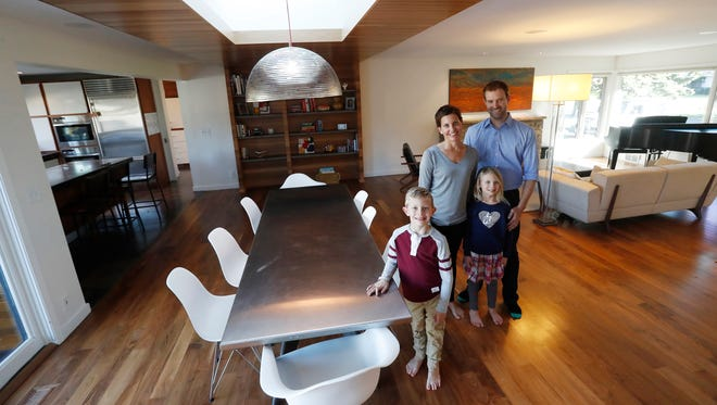 Homeowners Jill and Robert Prevost and 6-year old twins Griffin and Siena pose for a portrait inside their revived 1950s rambler Thursday Oct. 13, 2016 in St. Louis Park, Minn.