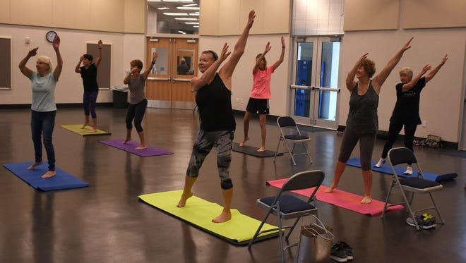 Essentrics participants go through a routine. Essentrics is one of the workout options offered at the new Mackle Park community center.