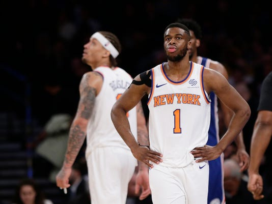 New York Knicks' Emmanuel Mudiay (1) and Michael Beasley react during the second half of an NBA basketball game against the Philadelphia 76ers, Thursday, March 15, 2018, in New York. (AP Photo/Frank Franklin II)