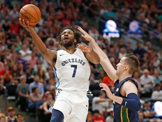 Grizzlies guard Wayne Selden (7) lays the ball up as Jazz forward Zach Thomas, right, defends during a Summer League game July 3.