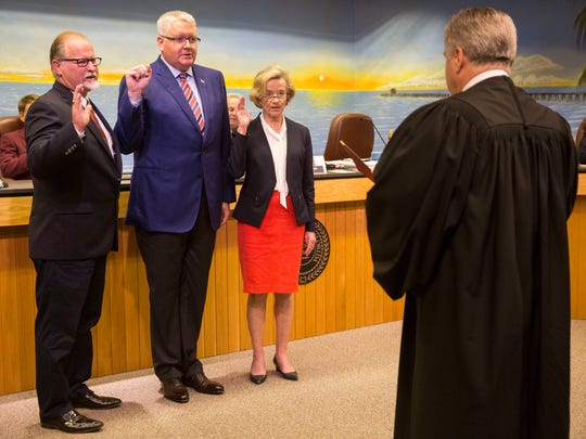 Terry Hutchison, from left, Gary Price and Linda Penniman are sworn into office at City Hall during the Naples City Council meeting on Wednesday, Feb. 21, 2018.