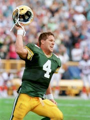 Brett Favre celebrates after Chris Jacke's extra point capped the Packers' 24-23 victory over the Cincinnati Bengals at Lambeau Field on Sept. 20, 1992.