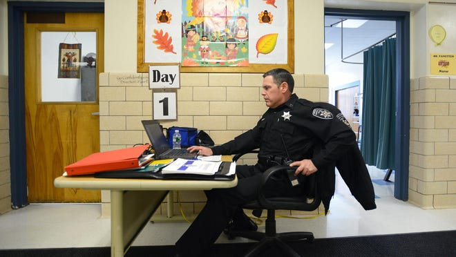 In this 2016 file photo, Mike Siriano, a special patrol officer for Oneida County Sheriff Office, checks the security cameras at Parkway Middle School in Whitesboro.