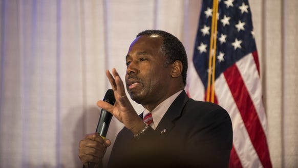 Ben Carson speaks at his caucus night party on Feb.