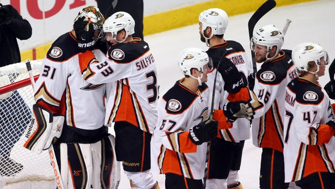 Anaheim Ducks goalie Frederik Andersen (31) is congratulated by teammates after defeating the Chicago Blackhawks 2-1 in game three of the Western Conference Final of the 2015 Stanley Cup Playoffs at United Center.