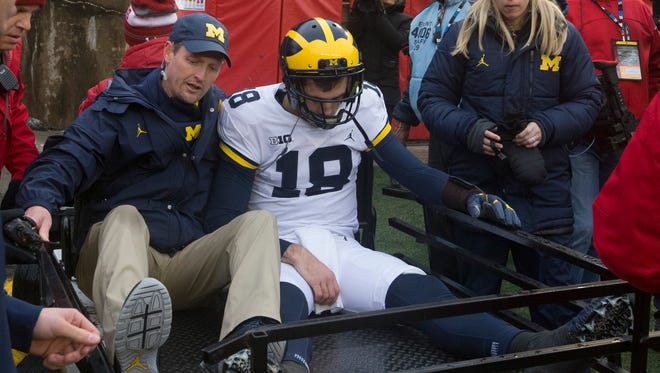 Brandon Peters is carted from the field after being injured during the third quarter Saturday.