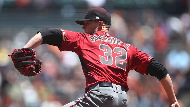 Arizona Diamondbacks pitcher Clay Buchholz works against the San Francisco Giants in the first inning of a baseball game Wednesday, June 6, 2018, in San Francisco. (AP Photo/Ben Margot)