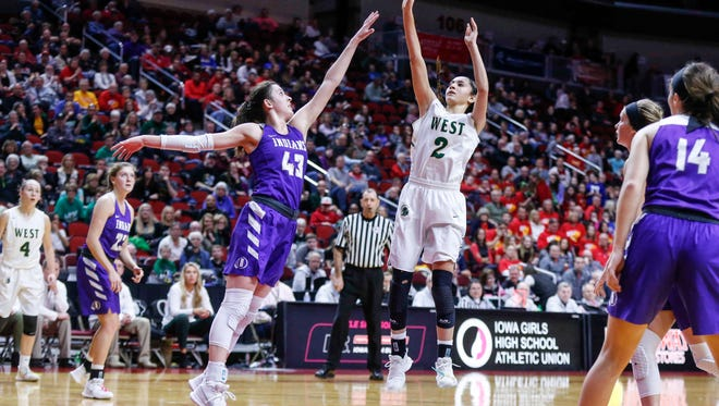 Iowa City West junior Cailyn Morgan launches a shot over the reach of Indianola senior Grace Berg during the 5A semifinal game at the girls state basketball tournament on Thursday, March 1, 2018, at Wells Fargo Arena in Des Moines.