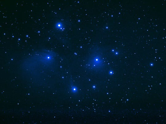The Pleiades, a blue open star cluster.
