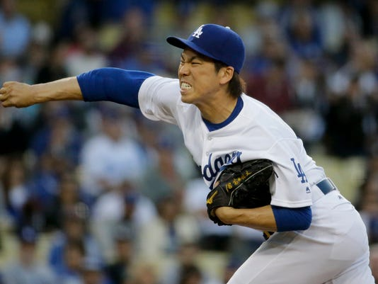 Los Angeles Dodgers starting pitcher Kenta Maeda, of Japan, throws against the New York Mets during the first inning of a baseball game in Los Angeles, Wednesday, May 11, 2016. (AP Photo/Chris Carlson)
