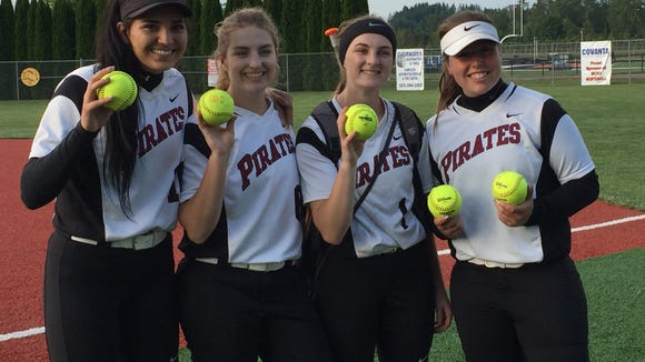 Dayton's Kalina Rojas (from left), Ani Heidt, Haley Couch and Kylee Hill hit home runs against Scio on Tuesday, May 30, 2017.