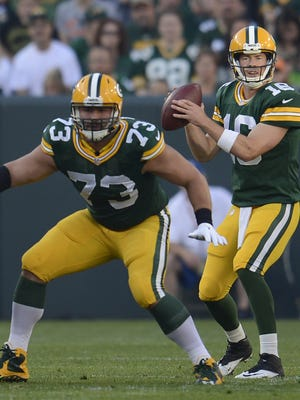 Packers quarterback Scott Tolzien (16) looks to throw a pass against the New Orleans Saints during a 2015 preseason game at Lambeau Field.