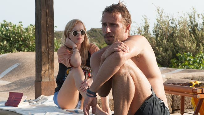 "Dakota Johnson and Matthias Schoenaerts in ""A Bigger Splash."""