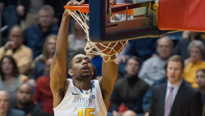 West Virginia's Terry Henderson dunks during the first half against Iowa State in Morgantown, W. Va.