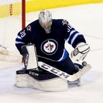 Winnipeg Jets goalie Connor Hellebuyck makes a save against the Colorado Avalanche on Jan. 18, 2016.