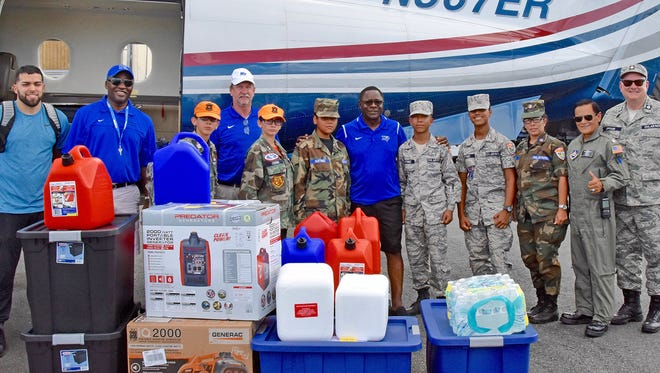Members of the MTSU Raider Relief team are shown Wednesday, Nov. 15, at the airport in San Juan, Puerto Rico, with volunteers from the Puerto Rico Wing of the Civil Air Patrol. The group was preparing to distribute a load of supplies flown to the island by Raider Relief to assist the family of former Blue Raider basketball star Raymond Cintron.