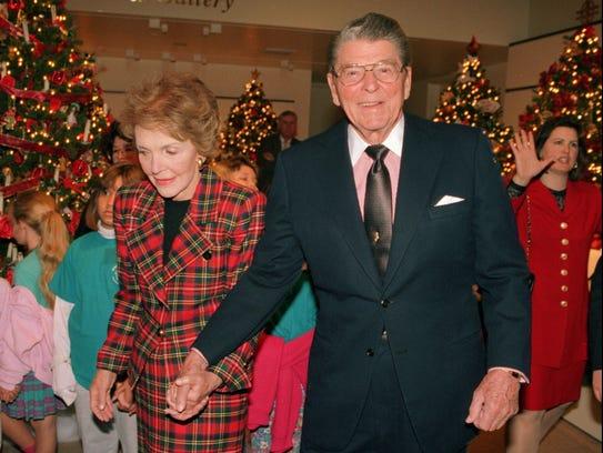 """The Reagans tour the """"Christmas Around the World"""" exhibit"""