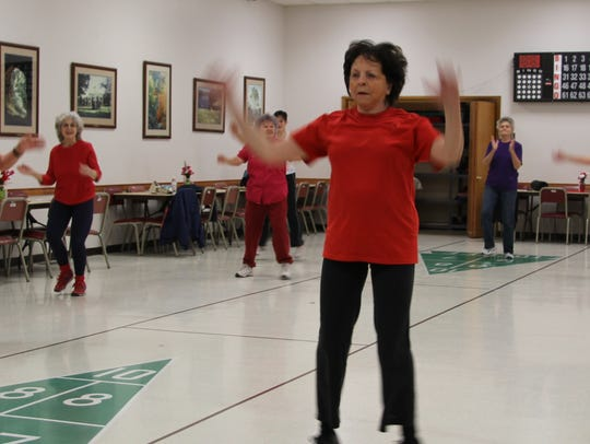 Being cheered on by her class, Margaret McClure,80,