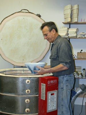 Local potter Alan Newman is preparing porcelain pottery for the Salem Art Fair and Festival in July.