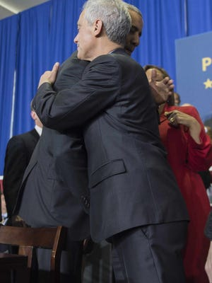 President Obama (L) and Chicago Mayor Rahm Emanuel (R) hug after speaking at Gwendolyn Brooks College Preparatory Academy in  Chicago, Illinois, February 19, 2015. Obama designated the Pullman Historic District as a National Monument. The district was founded by railroad car manufacturer, engineer and industrialist George Pullman in 1880.