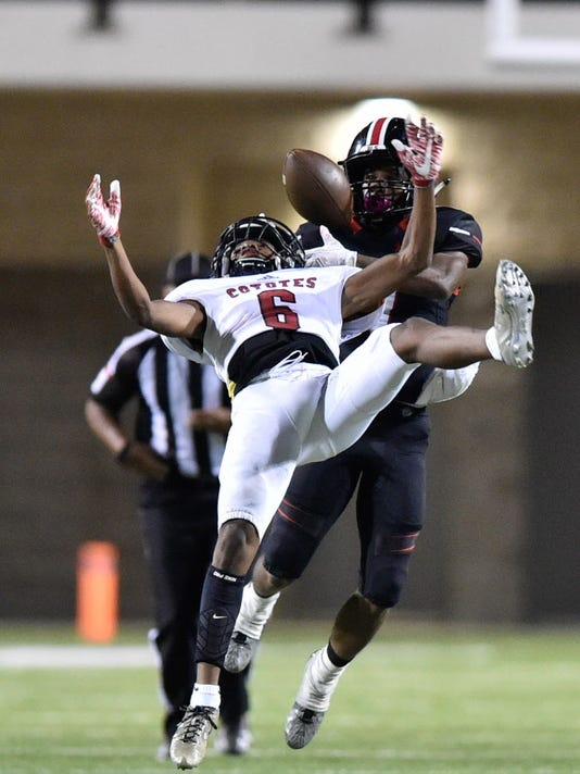 Braswell senior defensive back Caleb Richardson (7) intercepts a pass thrown to Wichita Falls junior wide receiver A.J. Byrd (6) at C.H. Collins Athletic Complex