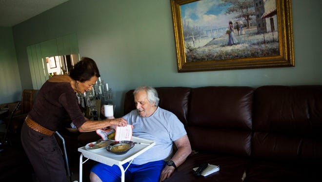 Mina Maffucci serves lunch to her husband, Angelo, 84, at their home in Naples, Florida, on Friday, April 7, 2017. The Maffuccis have been dependent on a weekly bag of food provided by the Jewish Family and Community Services of Southwest Florida for years, along with the free lunch at the Senior Center each Wednesday. Without it, given the deductibles on his medical expenses, Angelo estimated they'd be limited to two meals a day.