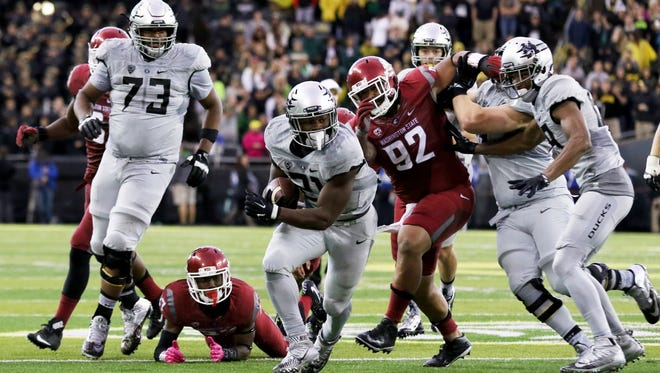 Oregon running back Royce Freeman (21) runs the football during overtime of an NCAA college football game against Washington State Saturday, Oct. 10, 2015, in Eugene, Ore.