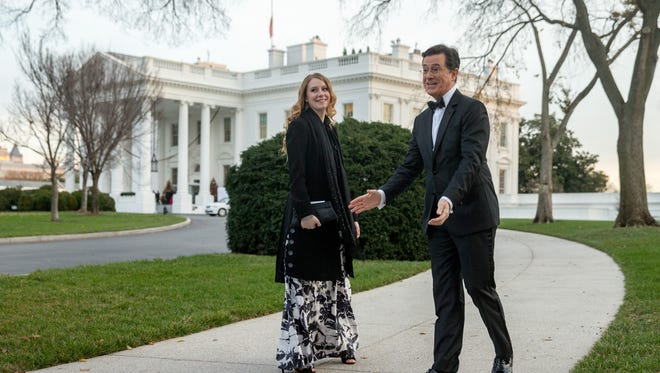 Performer Stephen Colbert, accompanied by his daughter Madeleine, arrives for the 2015 Kennedy Center Honors reception held in East Room of the White House in Washington, Sunday, Dec. 6, 2015, in Washington. The 2015 Kennedy Center Honors Honorees are singer-songwriter Carole King, filmmaker George Lucas, actress and singer Rita Moreno, conductor Seiji Ozawa, and actress Cicely Tyson.