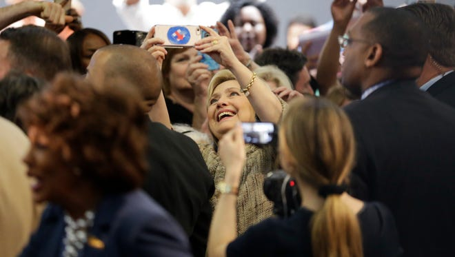 Democratic presidential candidate Hillary Clinton, center, takes a selfie with supporters during a campaign event at the Los Angeles Southwest College on Saturday, April 16, 2016, in Los Angeles.