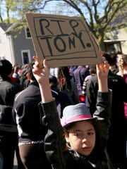 A young participant  holds a sign during a demonstration for Tony Robinson along Williamson Street in Madison on Wednesday, May 13, 2015.